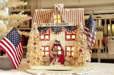Old Glory Colonial Cottage will make you want to have this beauty lit all year long. She stands tall and proud. Display it all year or bring her out during the Holidays, and believe me, there are many holidays she can represent. There is a 1 inch hole in the back to accommodate a one light bulb village light or a string of mini lights. The trees are bleached and embellished with red, white, and blue beads. An American flag stands proud on the side of the house. Finished off with mica flakes…