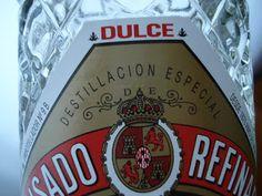 Error ortográfico de la botella, DESTILLACIÓN con dos LL