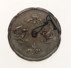 Mirror - 8th century - Tang dynasty  Bronze - H: 1.1 W: 15.7 D: 1.1 cm  China