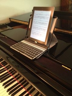 Hugh Sung of AirTurn finds that his Adonit Writer Plus Bluetooth keyboard can serve as a piano rack for his iPad, in a pinch. Digital Sheet Music, Bluetooth Keyboard, Ipads, Writer, Gadgets, App, News, Sign Writer, Apps
