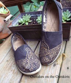 Use a gold fabric pen to amp up canvas shoes.