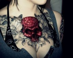 female red skull chest tattoo chest tattoo tat cleavage decollete skull woman girl photo photograph skeleton