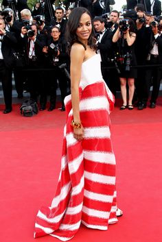 Zoe Saldana at Cannes in 2011 wearing Giorgio Armani long bustier gown in white silk organza with red and white stripe cascading skirt