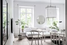 White home with lots of green - via Coco Lapine Design blog