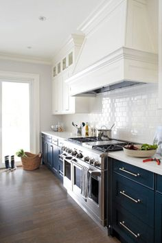 Navy lowers, white uppers, & subway tile, hood