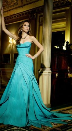 Versace blue-green dress that's very outgoing and free flowing. hey, that rhymed!