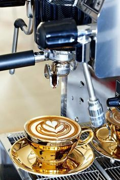 love the gold cup and the coffee art.