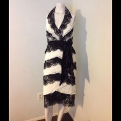 Tadashi Silk Lace Tiered Dress Satin Bow Dress Very pretty Tadashi dress. Tiered style - silk chiffon with black lace and a Satin bow. Halter style. Size 6. This dress has been dry cleaned. Great condition Tadashi Dresses