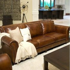 Paladia Top Grain Leather Sofa and Loveseat Set in Rustic by Elements Fine Home Furnishings. $1869.99. Leather Sofa, Leather Furniture. PAL-S-RUST-1-NH025 Features: -Traditional roll arm.-Antiqued brass nail heads along the arms and base.-Tailored high roll back.-Dark brown wood bun feet.-Hardwood frame encased in high density foam. Includes: -Set includes sofa and loveseat. Options: -Upholstered in rustic top grain leather. Assembly Instructions: -Assembly required. Collect...