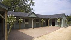 Six stables, tack room, hay store, wash room and feed room designed and built by The Stable Company.