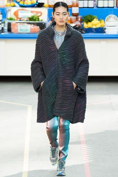Chanel   Fall 2014  Gorgeous! This iridescent coat, OUT OF 78 LOOKS, was the only one that didn't make me feel sad and confused. Karl may be past it.