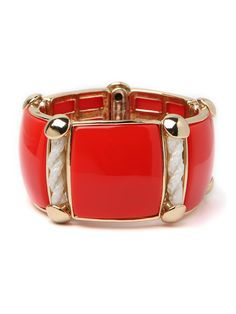 Minimalism gets a shot of Americana in bright coral wrist-wear.  Go for some laid-back luxe with a crisp lucite cuff featuring nautical details.  BB Spotting: As seen in white in Elle Magazine