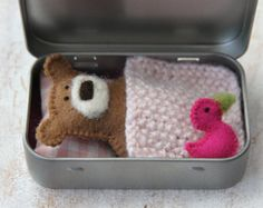 wee TEDDY in tin house, travel toy  This fellow is a cute little creature born on the little island in the Atlantic Ocean. Hidden in a tin he can be carried anywhere, either in your bag or your kids pocket, ready to play whenever needed!  This set would make a perfect gift for your little ones, supporting imaginative play. It is nicely packed in a cotton bag so it is ready to be given as a present.  The set consists of teddy - sewn from wool felt - natural brown, approx. 8 cm (3 inch) tall…