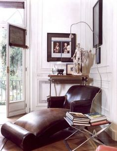 Brown + white: Leather chaise + white walls + art by xJavierx, via Flickr