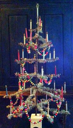 Feather tree with glass chains and glass candle lights ornaments.