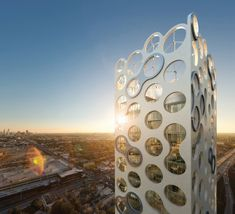 The COR residential high-rise by Oppenheim Architecture + Design has built-in wind turbines. AWESOME.