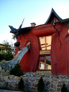 this house is situated in Banská Bystrica, Slovakia.    - whaaattt? I want a crazy house one day.