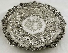 Large Georgian period English sterling silver footed salver. The center section hallmarked for William Fountain, London c1817 - the cast border is hallmarked for Joseph Angell, London c1823. (supershrink)