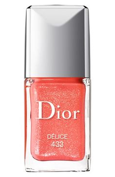 Dior Vernis Nail Lacquer in Delice, a beautiful coral with gold shimmer #coral