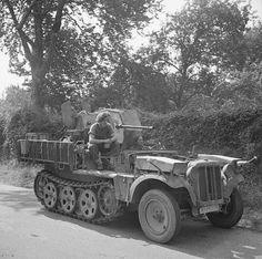 6th Airborne soldiers aboard a captured German half-track mounting a 20mm gun, which they used to shoot down a German aircraft, 28 August 1944