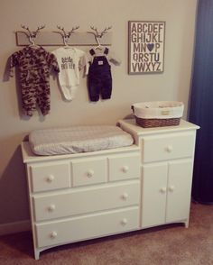 Baby boy nursery - rustic/hunting theme - like the hook idea for clothes