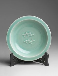 The Southern Song dynasty was a period of relative peace, which allowed a refined and introspective atmosphere to permeate court taste. This is reflected in the tranquil shapes and muted glazes of such classic Southern Song wares as southern celadon, Guan, and Ge wares. Of those Song ceramics given court patronage, however, few are as admirable and popular as the celadon ware produced at the Longquan kilns, typified by their simple, well-proportioned forms and their thick, lustrous…