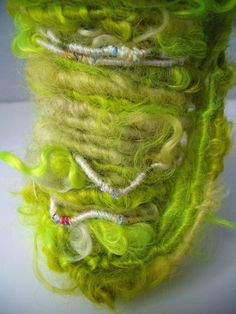 "MyMixMix on Etsy. ""Key Lime"" poquito skein of hand-dyed hand-spun Wensleydale locks with runs of core-spun wool thread throughout."