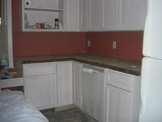 """We are using joists and beams salvaged from """"the back house"""" for counter-tops in the new kitchen."""
