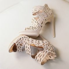 Su's fashion-forward nude, eyelet-cut booties added a glam look to her wedding ensemble.