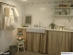 Burlap curtains like this might be so pretty around the ikea open shelving. and hide all the clutter! Shabby Cottage, Shabby Chic, Burlap Kitchen, Basement Inspiration, Vintage Laundry, Vintage Kitchen, Burlap Curtains, Cupboard Doors, Cottage Interiors
