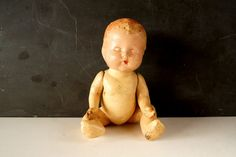 A collectible composition baby doll... Imagine all the little girls that rocked this baby to sleep and held it in their arms while singing their