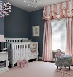 Elegant pink,white and gray baby girl nursery ideas. DIY butterfly baby mobile and pink and white curtains with wide stripes!