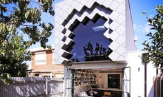 In what certainly could never be called a subtle move, Aussie architects Hook Turn Architecture have tacked on a massive tessellated bluestone box to the backend of a Victoria home in Brunswick East, a suburb just outside of Melbourne. Although the renovation process for the Quarry House called for retaining the original 1880s Victorian brick facade in the front, the architects decided to get playful with the back yard addition, plopping a locally-sourced bluestone cube with a gaping window…