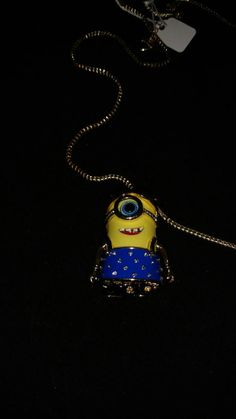 Check out this item in my Etsy shop https://www.etsy.com/listing/387149638/huge-crystal-girl-minion-necklace