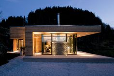 I can keep saying it: using wood doesn't mean building a sauna or cabin like house. Look at this one, modern, strong lines, lovely use of materials.