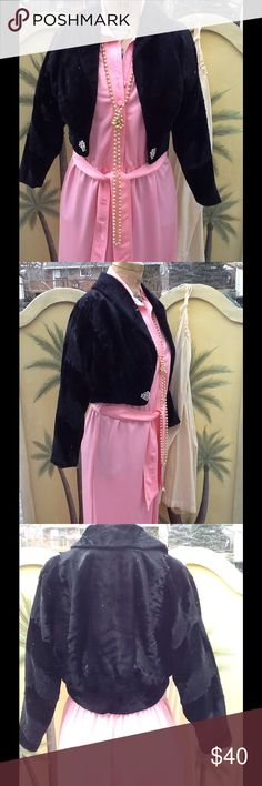"""VTG Faux Fur Bolero Jacket w/ Rhinestone closure This is beautiful,I just love it too bad it's too small for me! It's in a black faux fur w/ shawl style collar 3/4"""" sleeves and it's blousoned in the back,it's a fitted empire waist,and fully lined ,no tags only issue it has is the hook is broken off of the one closure to clasp it closed,I suppose you c an come up with another way to keep it closed or just leave it open...it's in EUC other than what is mentioned...measurements:L:18"""", B:18""""…"""