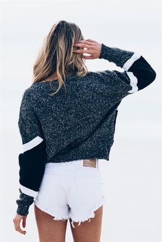 Cropped grey sweater and high waisted white shorts.