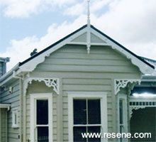 Resene Half Bison Hide on all weatherboards, Resene Eighth Thorndon Cream on all windows/trims and Resene Grey Friar for roof and doors