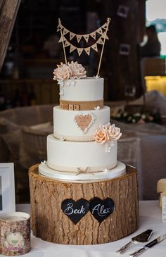 Hessian and peach roses wedding cake with scrabble letters and bunting topper.