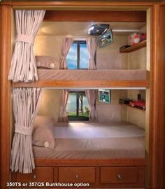 Forest River Georgetown class A motorhome bunks drop down tvs and built in shelves. something like this for kids Camper Bunk Beds, Kids Bunk Beds, Caravan Bunks, Interior Motorhome, Modern Bunk Beds, Camper Renovation, Camper Makeover, Camping Car, Camping Places