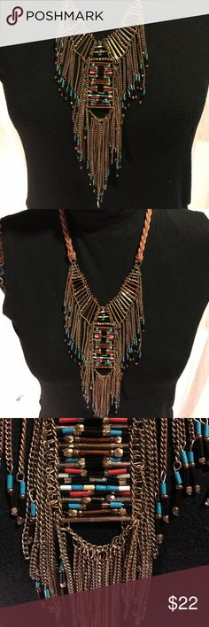 Tribal gold & leather necklace Adjustable necklace with accents of coral & blue. Never worn. Express Jewelry Necklaces