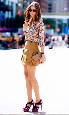 Olivia Palermo in a printed blouse, khaki skirt and bright pink platform heels