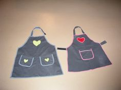 Children's aprons made from upcycled adult sized pant legs. Velcro at neck and back ties.
