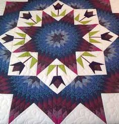 Broken Star with Tulips Pattern made by Lena for Almost Amish. Pattern for quilt center is Spring Star designed by Judy Martin for Shining Star Quilts in 1987.