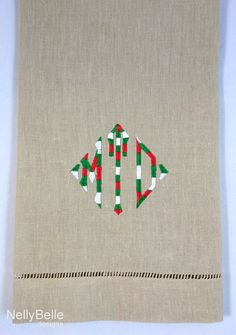 Christmas colors for a monogrammed guest towel. NellyBelle Designs