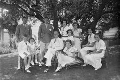 A portrait of the Kennedy family as they sit in the shade of some trees, Hyannis, Massachussetts, 1930s. Seated from left, Robert Kennedy (1925 - 1968), Edward Kennedy, Joseph P Kennedy Sr (1888 - 1969), Eunice Kennedy, Rosemary Kennedy (1918 - 2005), and Kathleen Kennedy (1920 - 1948); standing from left, Joseph P Kennedy Jr (1915 - 1944), John F Kennedy (1917 - 1963), Rose Kennedy (1890 - 1995), Jean Kennedy, and Patricia Kennedy (1926 - 2006).