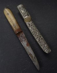 Antique Sino-Tibetan Knife - 19th CA nice antique Tibetan knife with bone and horn handle and decorated silver sheath with shagreen (ray skin) inlay. The handle is also inlaid with iron. The cased silver sheath is decorated with a dragon and crow motif. The blade displays weathering commensurate with age. Age: 19th C - length 7 inches