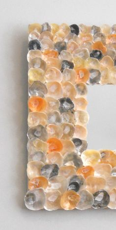 """Orange gold yellow silver and black jingle shell by madebymano, $395.00""  I collected about 300 of these shells on Sanibel, mostly gray, black, and pearl. It won't cost me $395. Will pin when done."