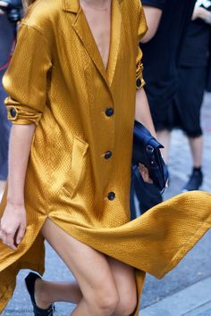 Fashion Week 2016: Oversized golden silk button up. High slits.   <3 @benitathediva