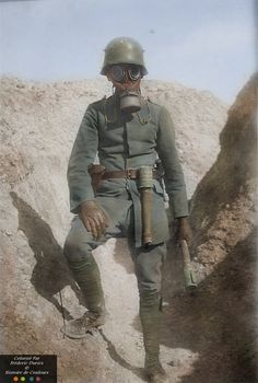 German trooper poses in the trenches with gas mask and potato masher hand grenades. The gas mask is to protect against the mustard gas. was the first war to use chemical warfare. Ww1 Photos, Colorized Photos, Military Art, Military History, World War One, First World, Ww1 History, British History, Ancient History